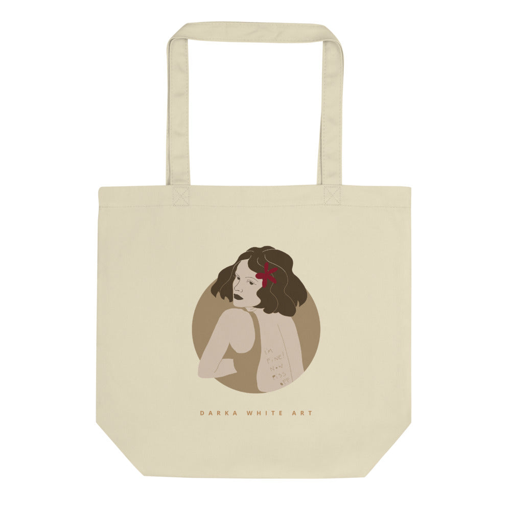 A tote bag with a beautiful illustrated art print of a woman's portrait and a sign