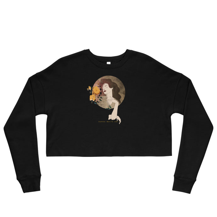 A black crop sweatshirt with a print. The print is a circled illustration of a woman's portrait. A sign says: