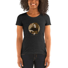 "Load image into Gallery viewer, A woman wearing a T-shirt with a print. The print is a circled illustration of a woman's portrait. A sign says: ""Darka White Art"""
