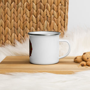 An enamel mug illustrated by Darka White. Mug is on a wooden desk, next to it are chocolate cookies.