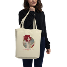 "Load image into Gallery viewer, A girl holding a tote bag in her hand. There's a beautiful illustrated art print of a woman's portrait on the bag and a sign ""Darka White Art"""