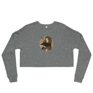 "A gray crop sweatshirt with a print. The print is a circled illustration of a woman's portrait. A sign says: ""Darka White Art"""