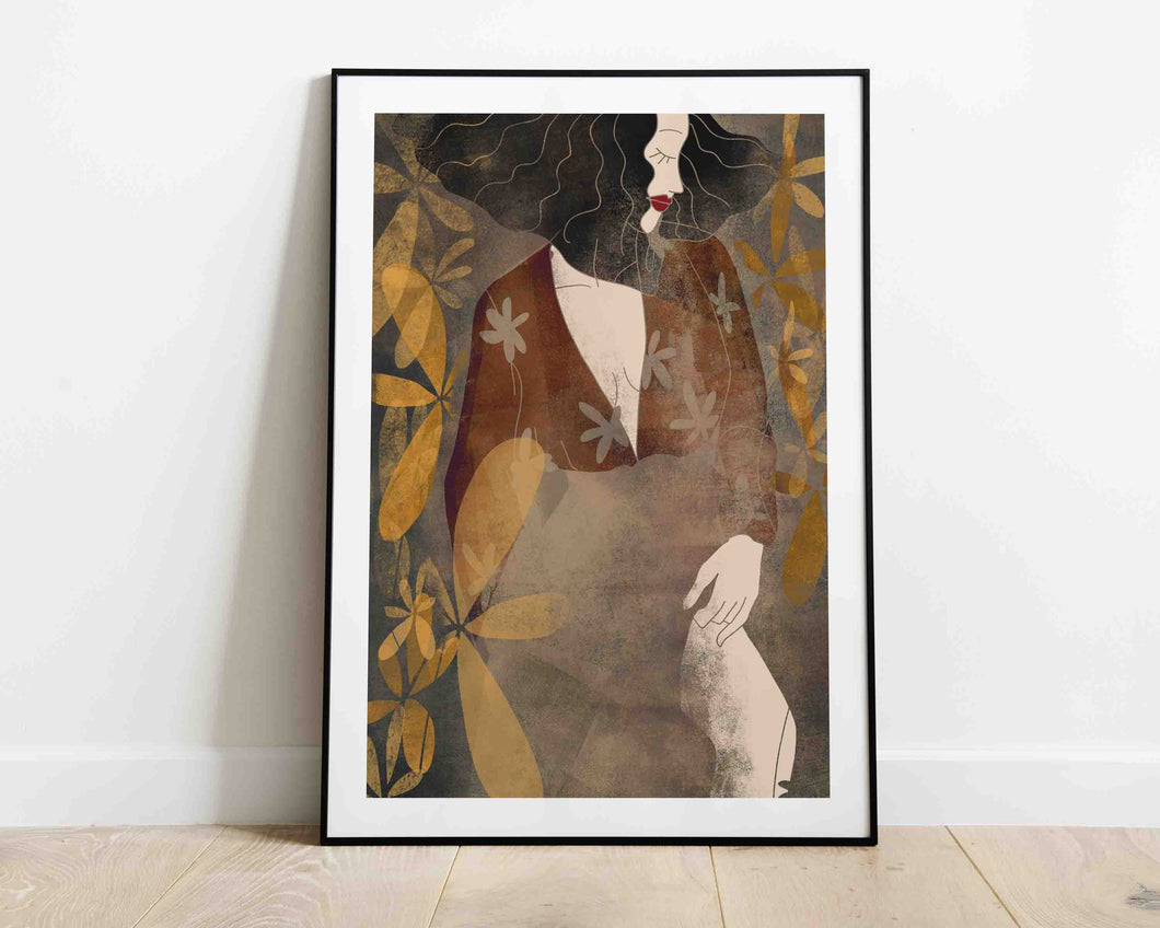 A framed stylized illustrated artwork of a female portrait surrounded with flowers by Darka White. Frame is on the floor leaning, on the wall.