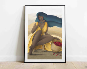 A framed illustration of a woman sitting on a small chair, she has a basket full of cherries in one hand and one cherry in the other. The artwork is by Darka White. The frame is on the floor, leaning on the wall.