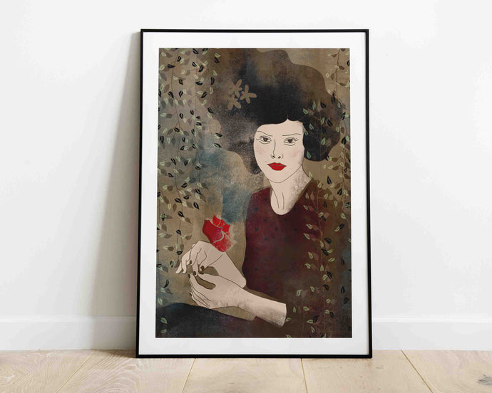 A framed stylized illustrated artwork of a female portrait by Darka White. Illustrated woman has a flower in her hands. Frame is on the floor, leaning on the wall.