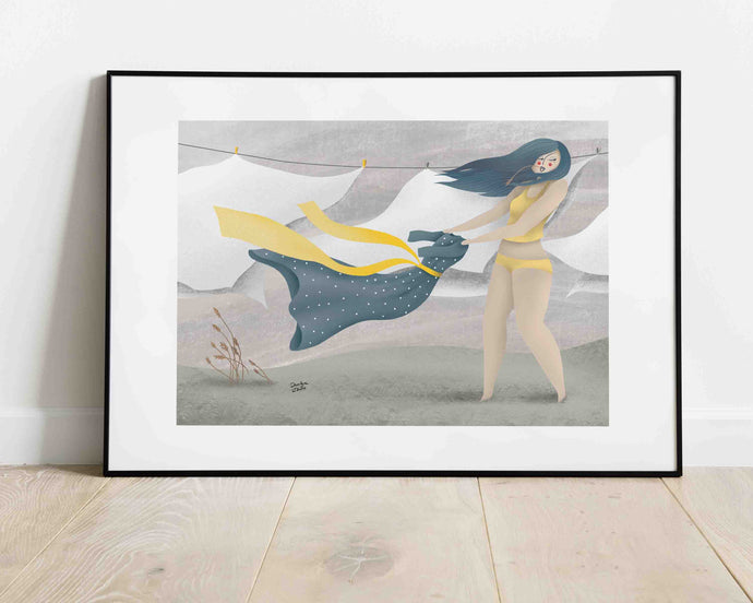 A framed illustrated artwork of a woman holding a dress in her hands. She's in her underwear, behind her are some sheets floating in the wind. Illustration by Darka White. The frame is on the floor, leaning on the wall.