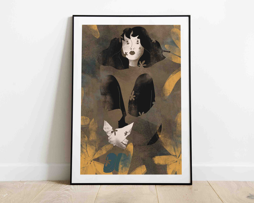 A framed stylized illustrated artwork of a female portrait by Darka White.  The frame is on the floor, leaning on the wall.