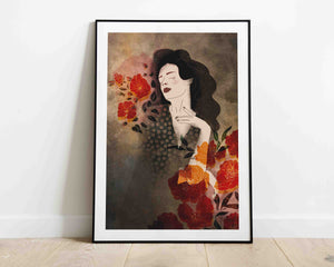 Framed artwork leaning on the wall: a stylized illustration of a female portrait with some flowers. Illustration by Darka White.