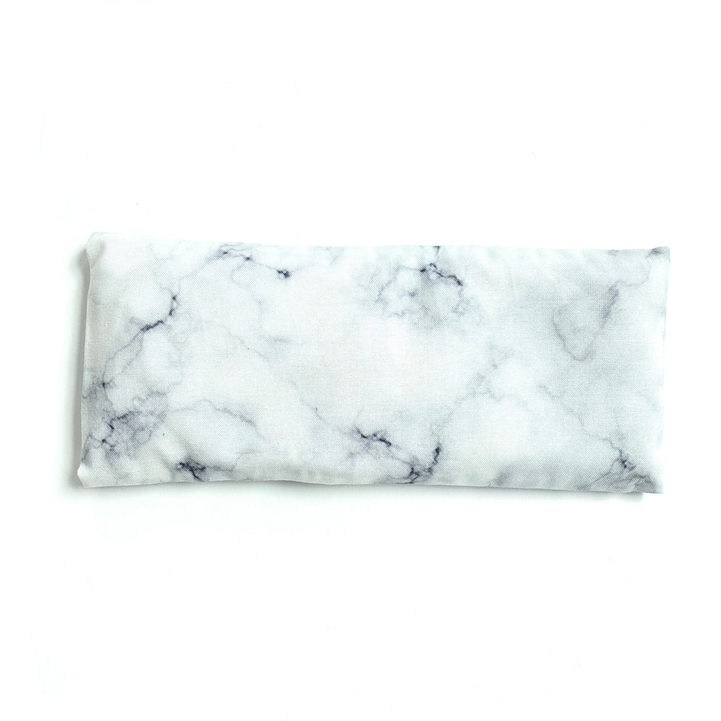 Lavender eye pillow with white hand dyed marble design, made in Toronto, Ontario, Canada.