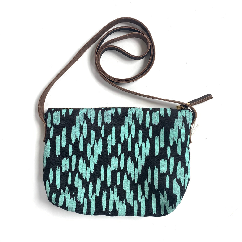 Linen crossbody purse with black and turquoise brushstroke design, made in Hamilton, Ontario, Canada.