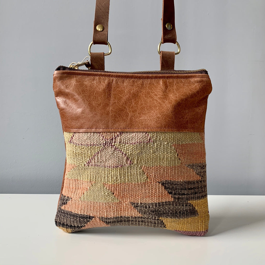 Made in Canada leather crossbody bag purse with Moroccan fabric accent.