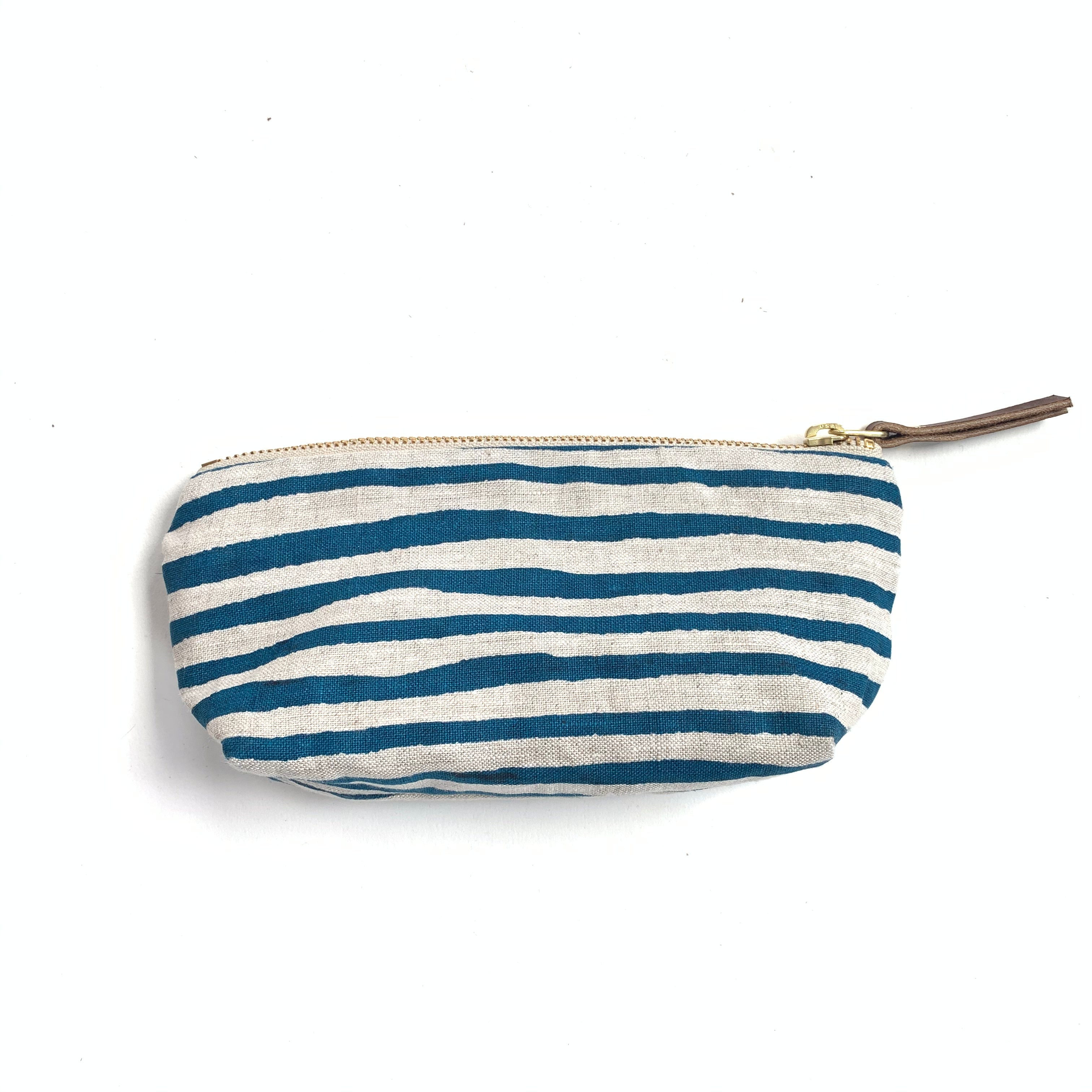 Made in Canada oblong pouch with blue and white tahle stripes.