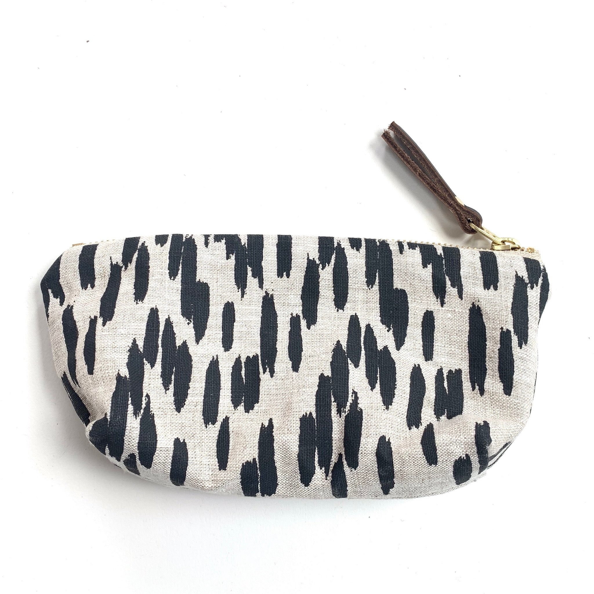 Made in Canada oblong linen pouch with black and white brushstroke pattern.