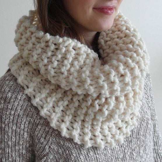 Girl wearing white Made in Canada hand knit wool cowl scarf.