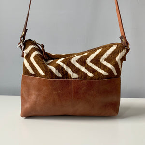 Made in Canada brown mudcloth crossbody bag purse with leather strap and backside.