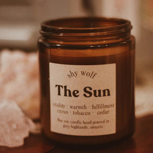 Made in Canada The Sun natural soy candle scented with citrus, tobacco, cedar.