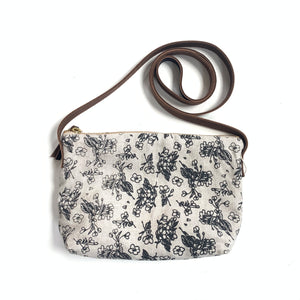 Linen crossbody purse with black and white floral design, made in Hamilton, Ontario, Canada.