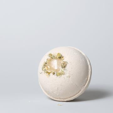 Canadian Made yellow bath bomb with orange chamomile and citrine gemstone.
