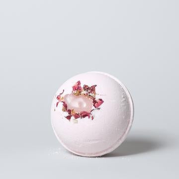 Canadian made pink bath bomb with rose quartz gemstone.