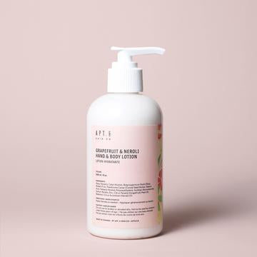 Canadian made Grapefruit Neroli hand and body lotion in a pink bottle.