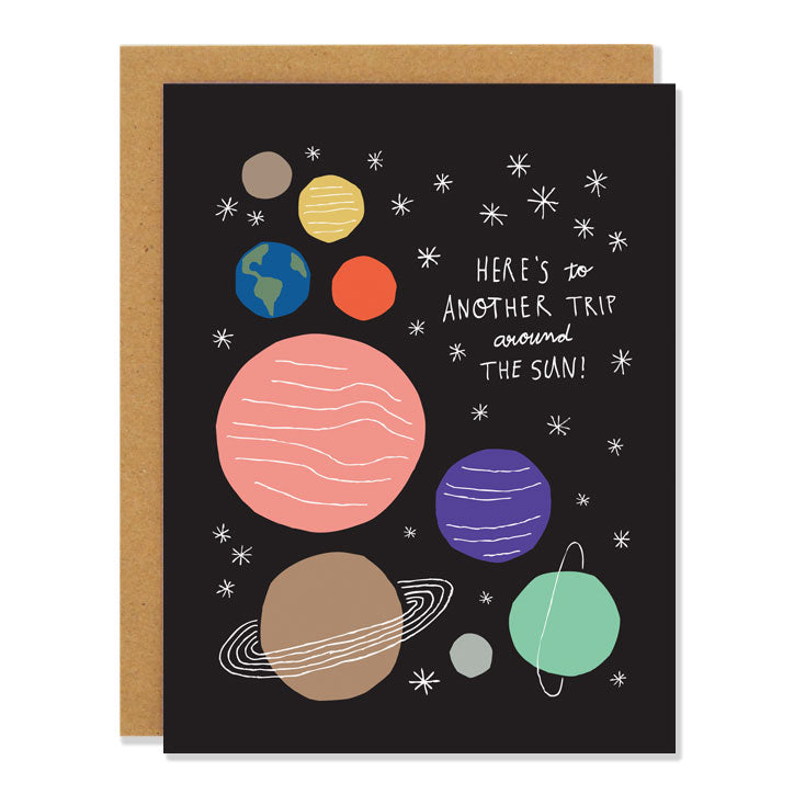 Made in Canada Birthday card with solar system design with nine planets and stars. Caption reads: Here's to another trip around the sun!