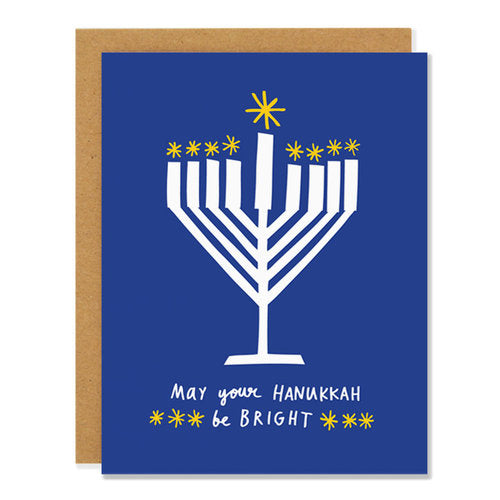 Made in Canada Hanukkah card with a white menorah on a blue background. Caption reads: May your Hanukkah be bright.