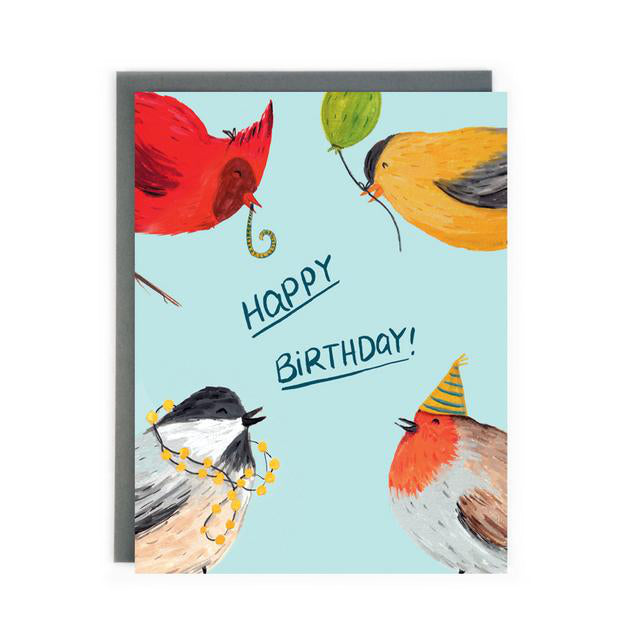 Canadian Made birthday card with a painting of a cardinal blowing a streamer, a chickadee with lights on its head, a goldfinch holding a balloon and a sparrow wearing a party hat. Caption reads: Happy Birthday!