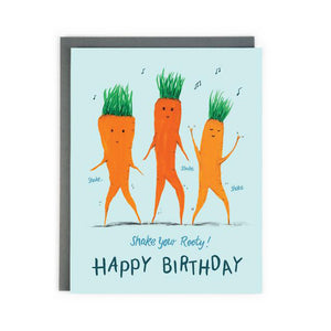 Canadian made birthday card with a painting of three dancing carrots with music notes above their heads. Caption reads: Shake your Rooty! Happy Birthday