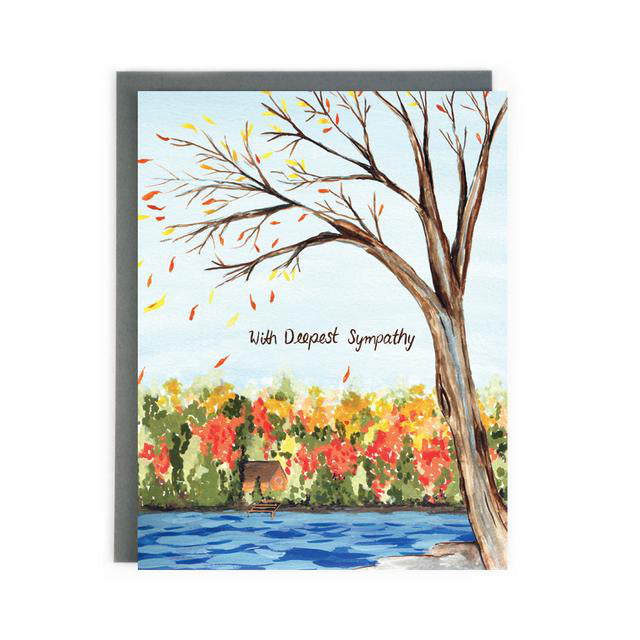 Made in Canada sympathy card with hand painted autumn scene of a cabin by a blue lake, with red and yellow leaves on the trees. Caption reads: With Deepest Sympathy