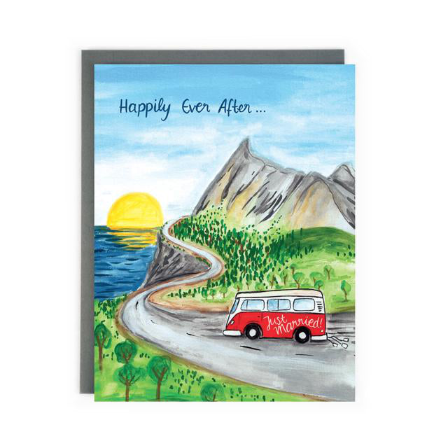 Made in Canada wedding card with hand drawn scene of a vintage Volkswagen Camper Van with Just Married written on the side, driving up a windy coastal road into the sunset. Caption reads: Happily Ever After