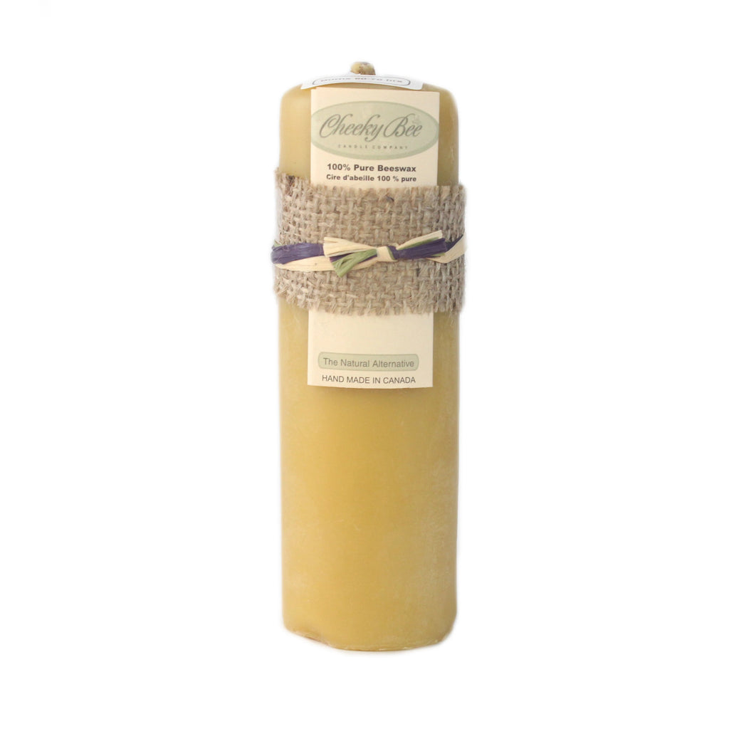 Tall and skinny pure yellow Canadian beeswax pillar candle, handmade in Canada.