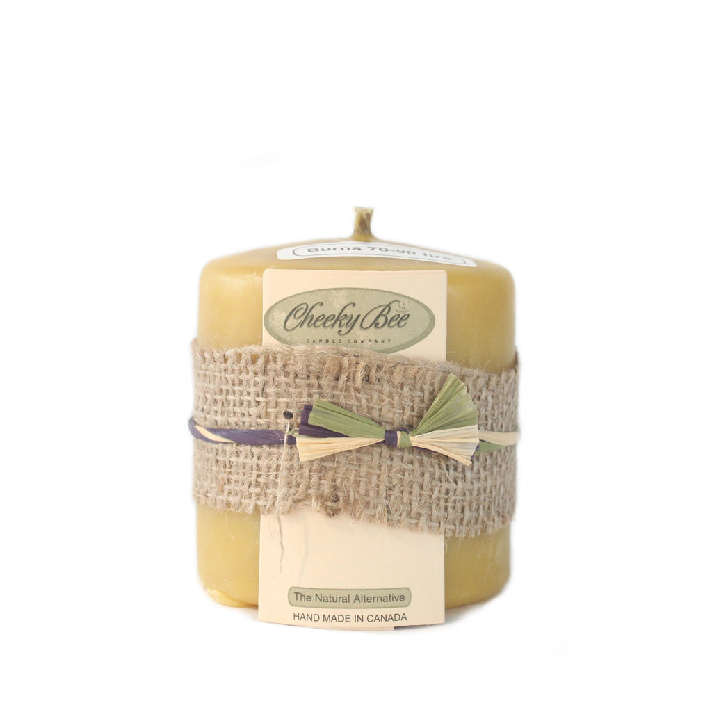 Short and stout pure yellow Canadian beeswax pillar candle, handmade in Canada.