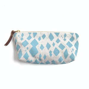 Made in Canada oblong linen pouch with light blue diamond print pattern.