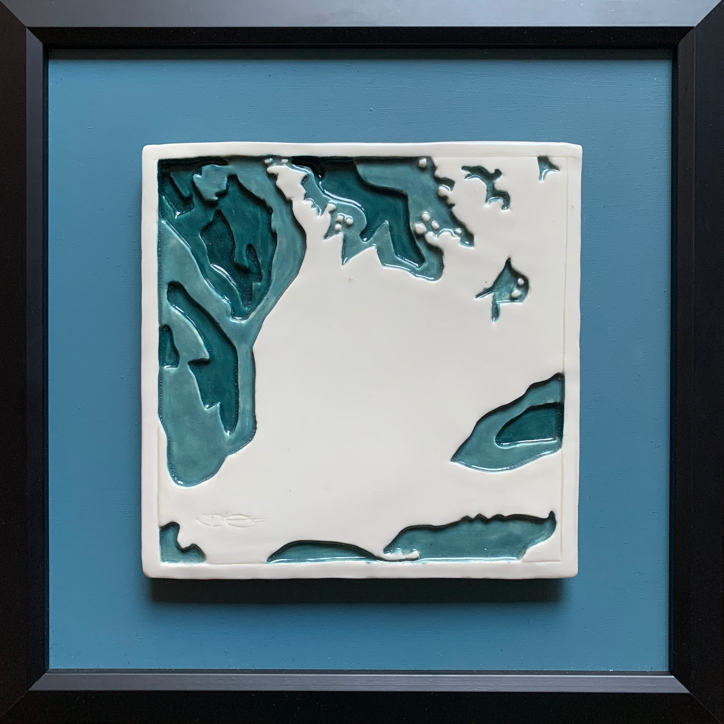 Made in Canada ceramic bathymetry tile art of Lake Huron, Georgian Bay, Lake Ontario,  Erie and Simcoe. White tile on blue backing in black frame.