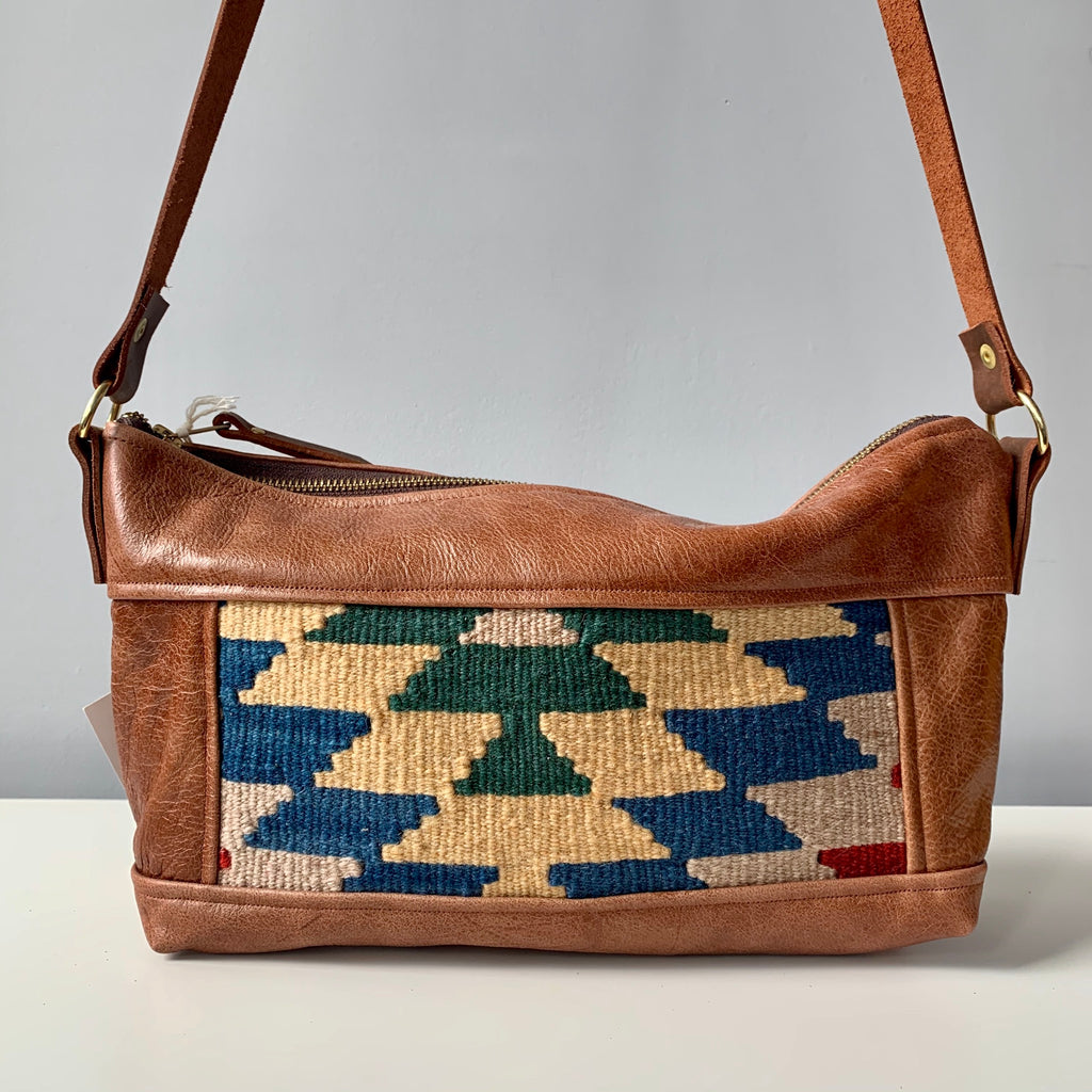 Made in Canada leather shoulder bag purse with blue and green Moroccan fabric accents.