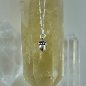 Made in Canada Justine Brooks tiny silver acorn charm necklace.