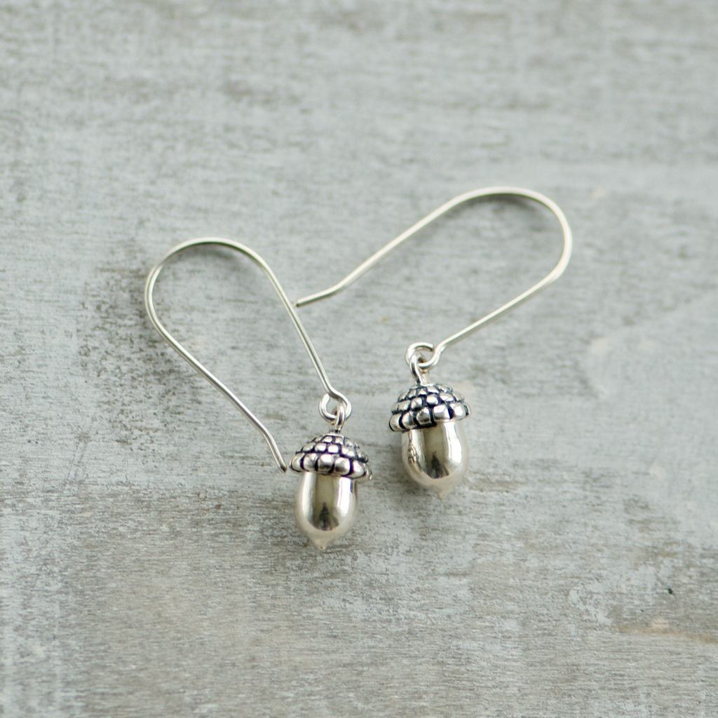 Made in Canada Justine Brooks tiny silver acorn drop earrings.