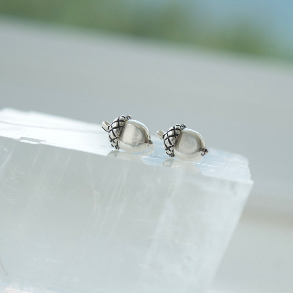 Made in Canada Justine Brooks tiny silver acorn stud earrings.