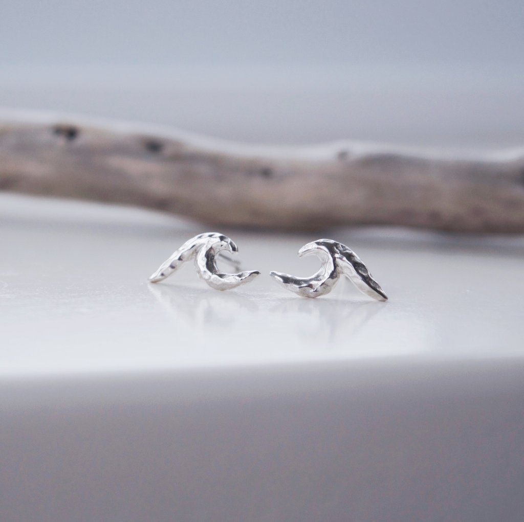 Made in Canada Justine Brooks silver textured wave stud earrings.