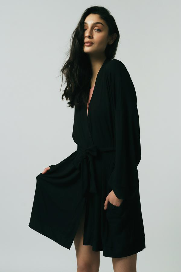 Woman wearing black Made in Canada bamboo robe.