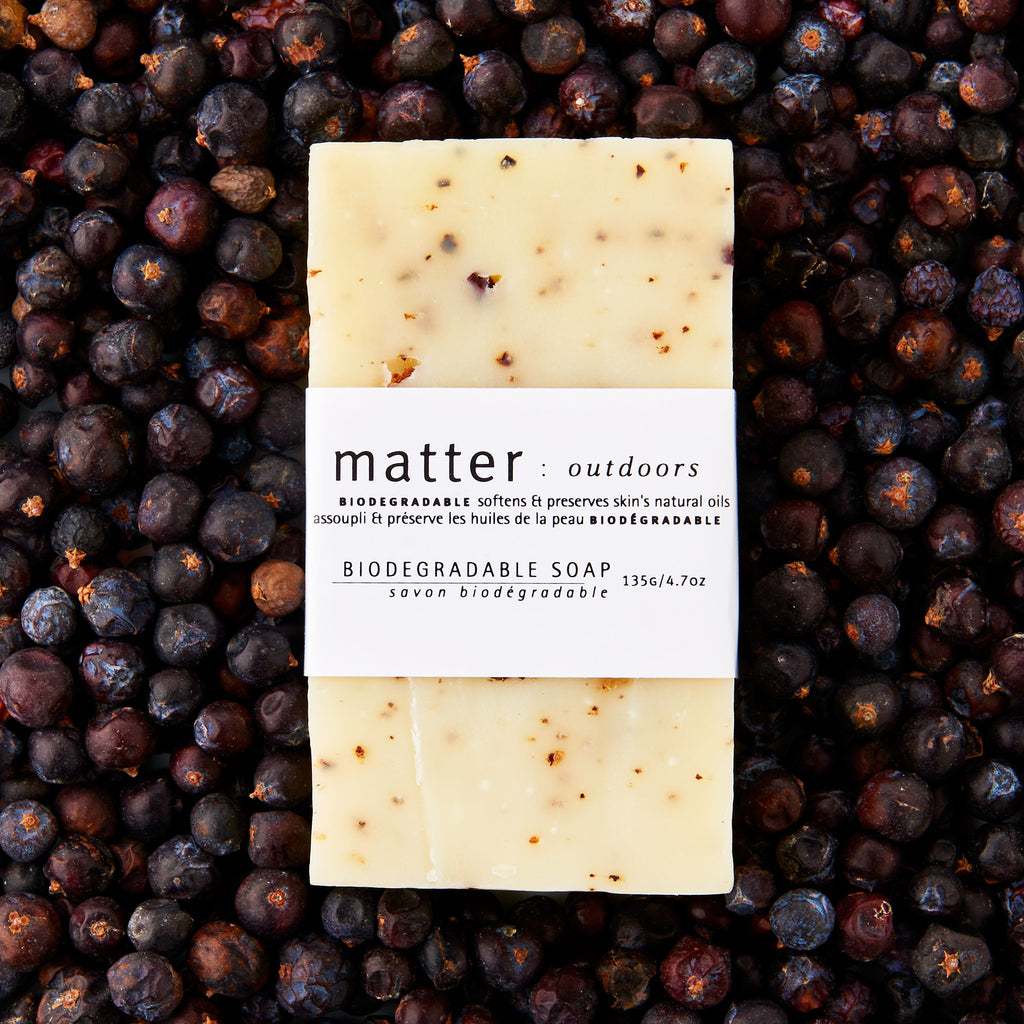 Made in Canada biodegradable soap by Matter Outdoors on a bed of dried juniper berries.