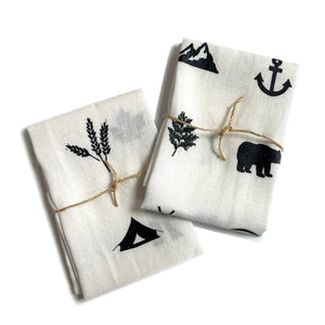 Canadian handmade white linen tea towels with Canadian themed symbols in black.