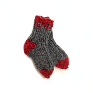 Hand knit red and grey wool baby socks, made in Canada.