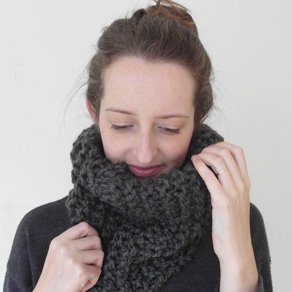 Girl wearing charcoal Made in Canada hand knit wool cowl scarf.