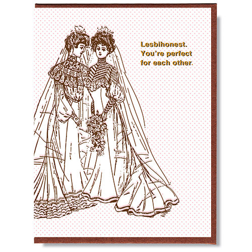 Made in Canada wedding card for lesbian couple, with drawing of two women wearing wedding dresses. Caption reads: Lesbihonest. You're perfect for each other.