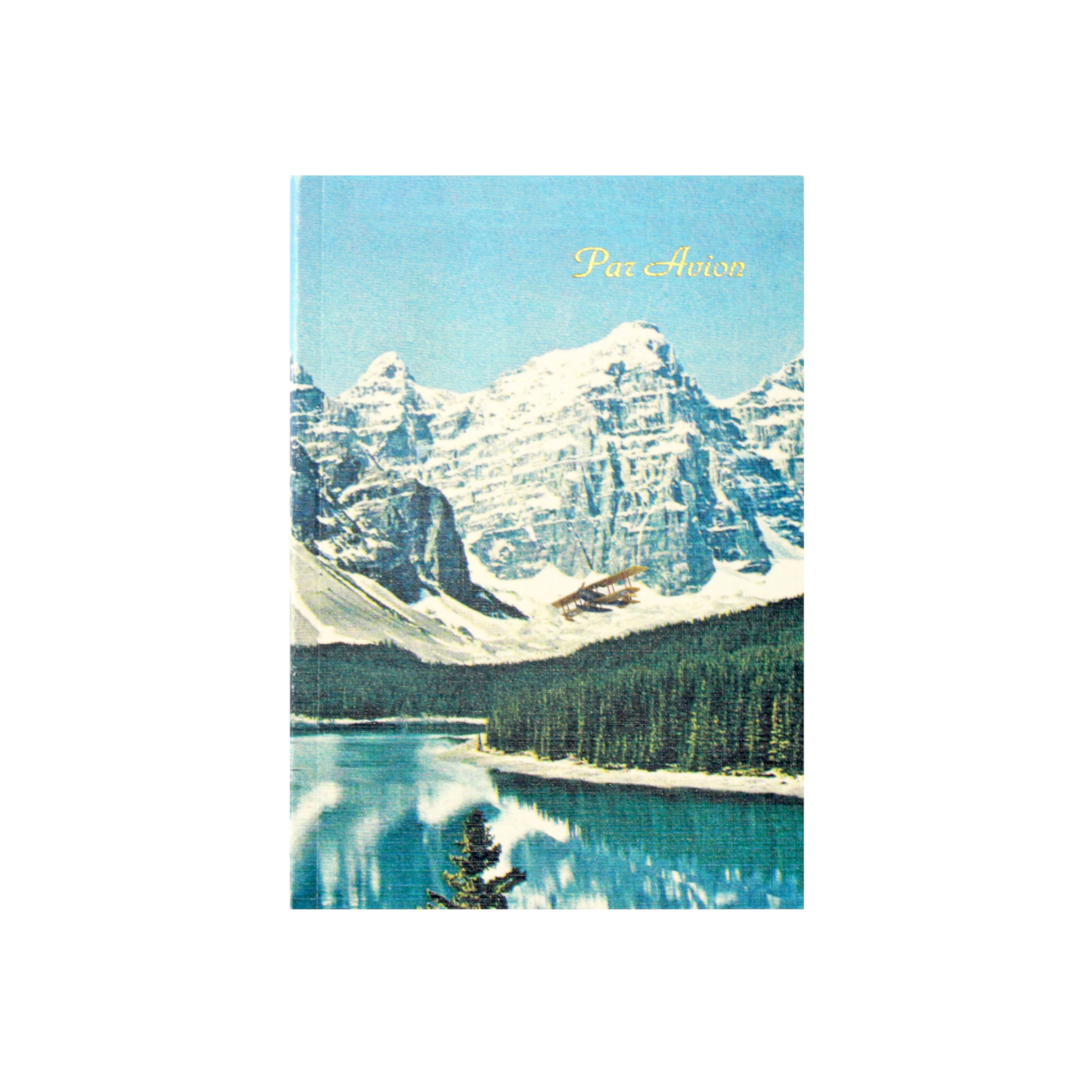 Canadian made notebook with a printed photograph of sea plane flying over Lake Louise in Alberta, Canada with snow covered Rocky Mountains in the background.