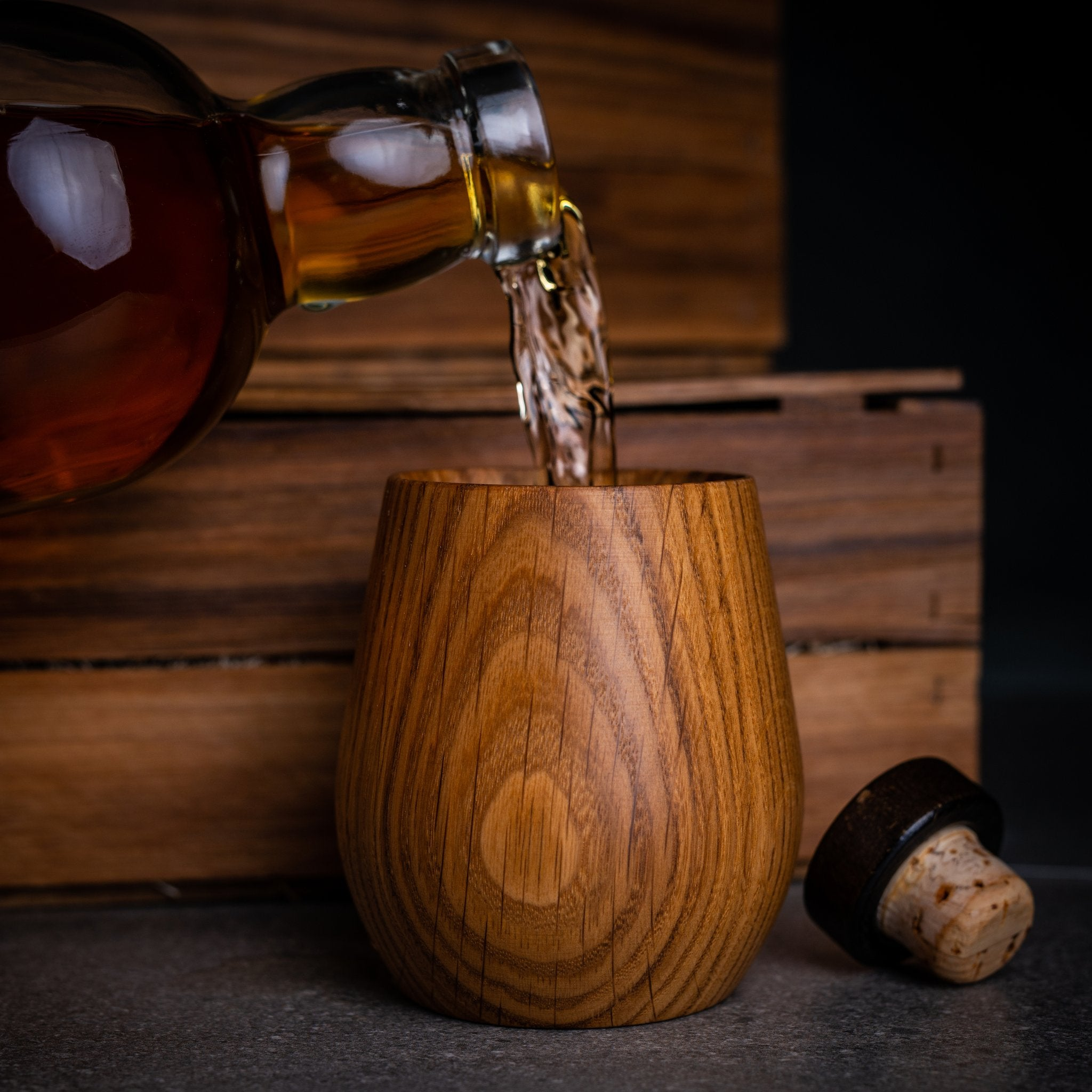Whisky being poured into a Canadian made oak whiskey tumbler by Stinson Studios.