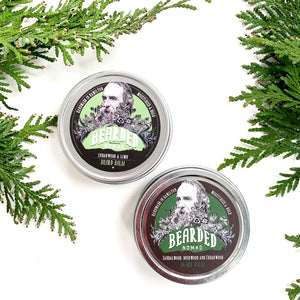 Two tins of Made in Canada all natural beard balm with cedar sprigs.