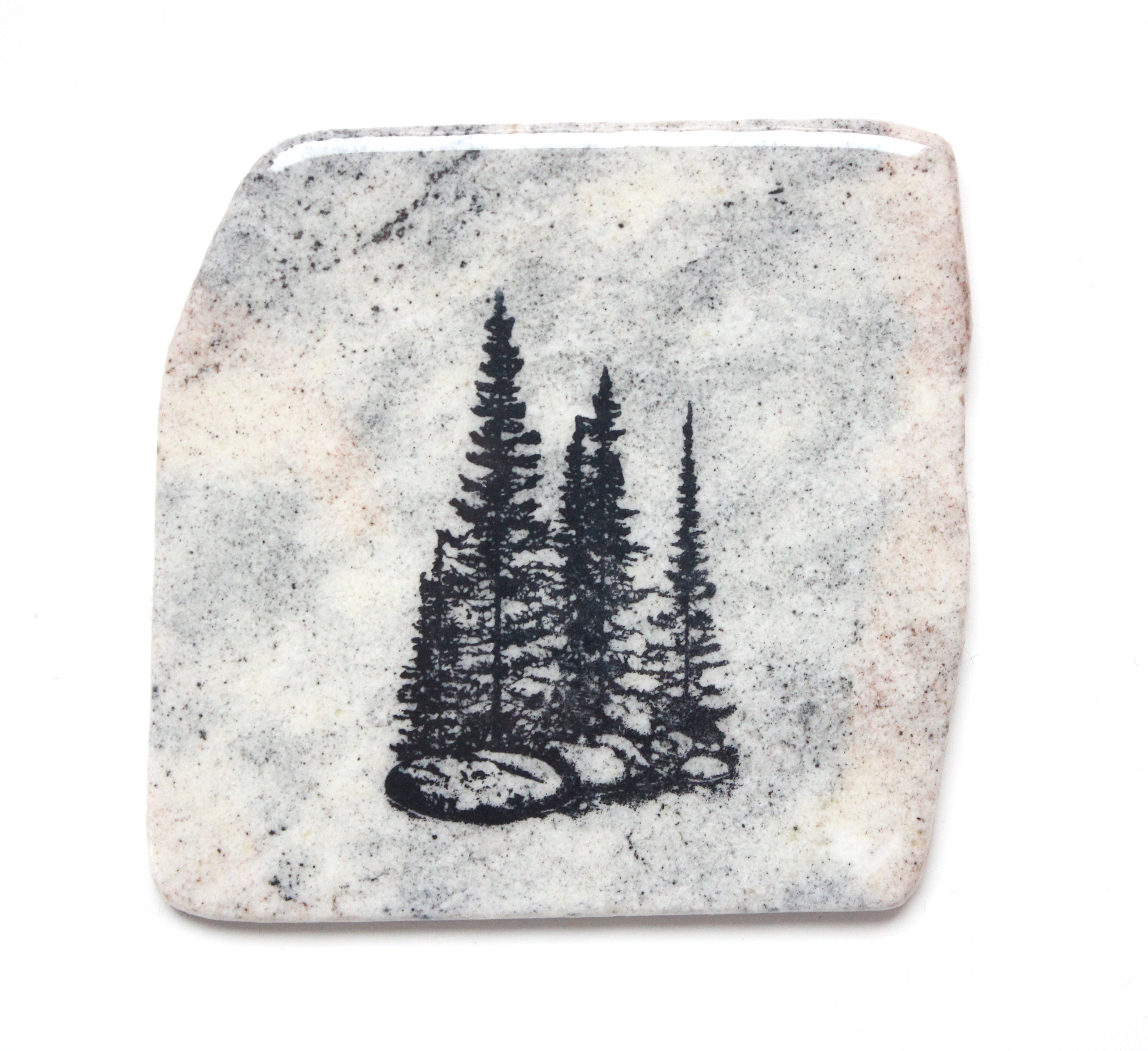White Made in Canada granite coaster with three pine trees print.