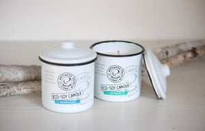 Two Canadian made eco soy candles in ceramic jars.